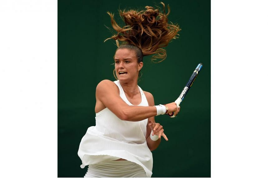 Greece's Maria Sakkari wears the Premier Slam dress during her match against Venus Williams on the fourth day of the 2016 Wimbledon Championships on June 30, 2016.