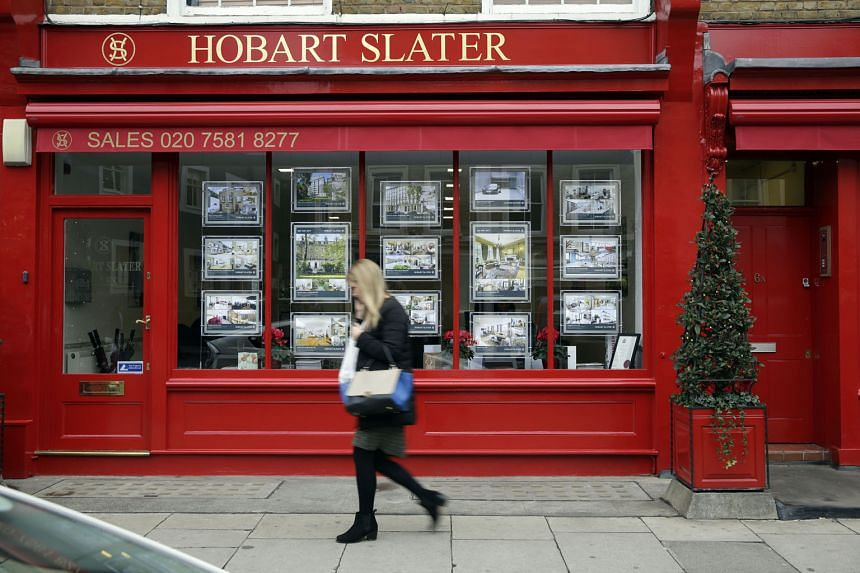 Residential property information leaflets displayed in the window of an estate agent in the Knightsbridge district of London in 2014. Unlike the escalating value of homes in the city then, analysts predict that the pendulum will swing the other way now, w