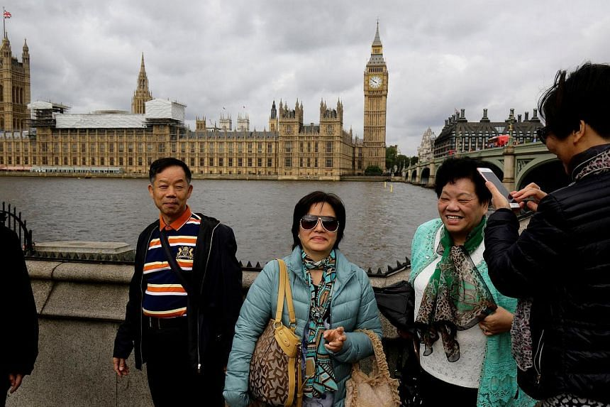 Chinese tourists standing near Big Ben in London on June 29.