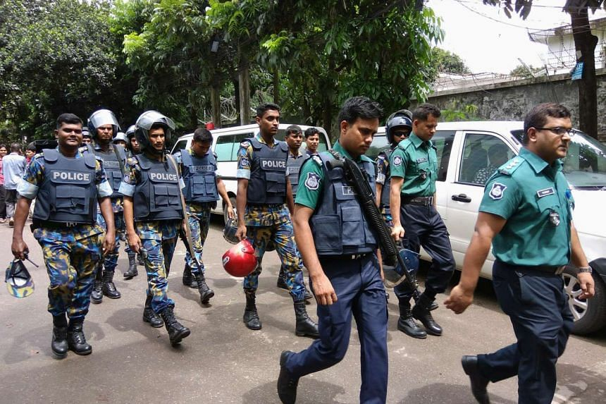 Security personnel are seen near the Holey Artisan restaurant hostage site, in Dhaka, Bangladesh, July 2.