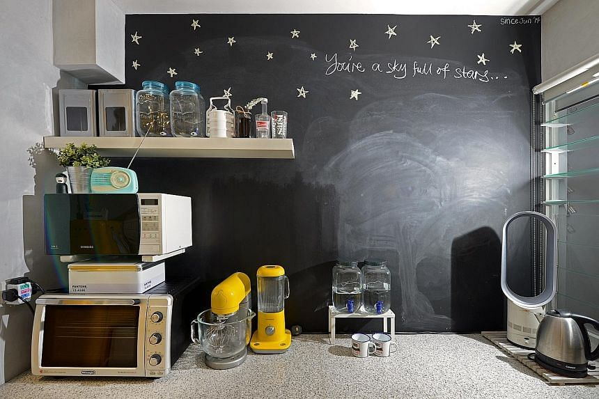 The chalkboard wall (above) in the kitchen is painted by home owner Muhammad Hamsani Hashim.