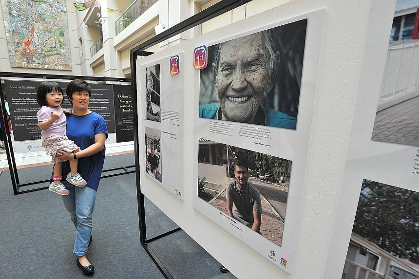 The winning photo entries of Aunty Mani and Mr Gowreesan on display at the atrium of Tan Tock Seng Hospital, along with 14 other entries from Ren Ci Nursing Home residents. The photos are part of the 1 Lens, 2 Photos, 3 Words exhibition launched yest