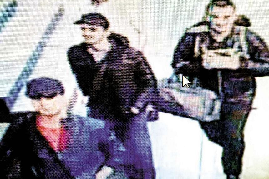 In this screengrab from CCTV video footage, the three men believed to be the attackers are seen walking in Istanbul's Ataturk Airport on Tuesday dressed in heavy clothing much too warm for summer.