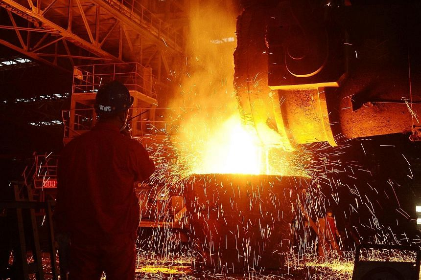 An employee working at a steel factory in Dalian, Liaoning Province. China's PMI ticked down to the 50 mark, which separates contraction from expansion.