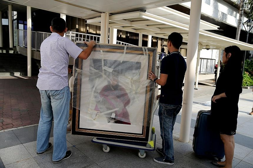 Paintings (right) being taken into court. Yang claimed he bought the Yin Ma Tu (below) for $500,000. Among those testifying were Mr Ngoh (above), Yang's then relationship manager at OCBC.