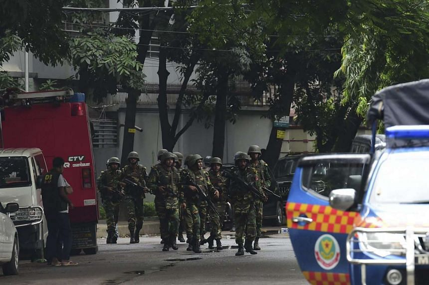 Bangladeshi army soldiers patrol during a rescue operation as gunmen take position in a restaurant in the Dhaka's high-security diplomatic district on July 2.