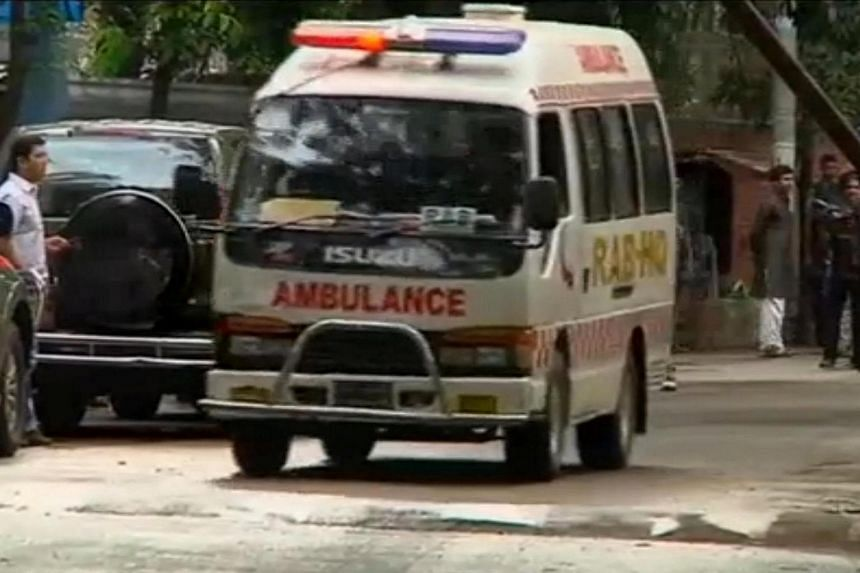 An ambulance is seen after police stormed the Holey Artisan restaurant to rescue hostages in Dhaka, Bangladesh, in this still frame taken from a video on July 2.