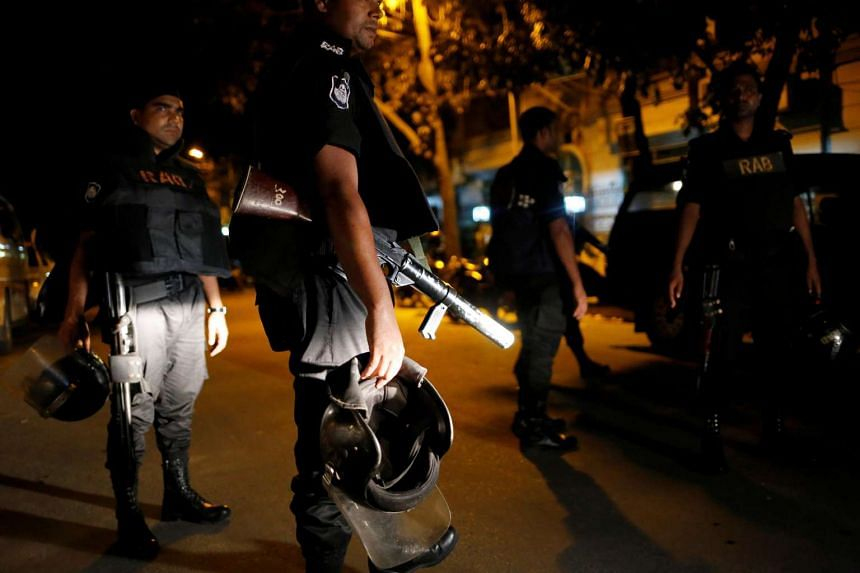 Security personnel keep watch after gunmen stormed the Holey Artisan restaurant and took hostages in the Gulshan area of Dhaka, Bangladesh, on July 2.