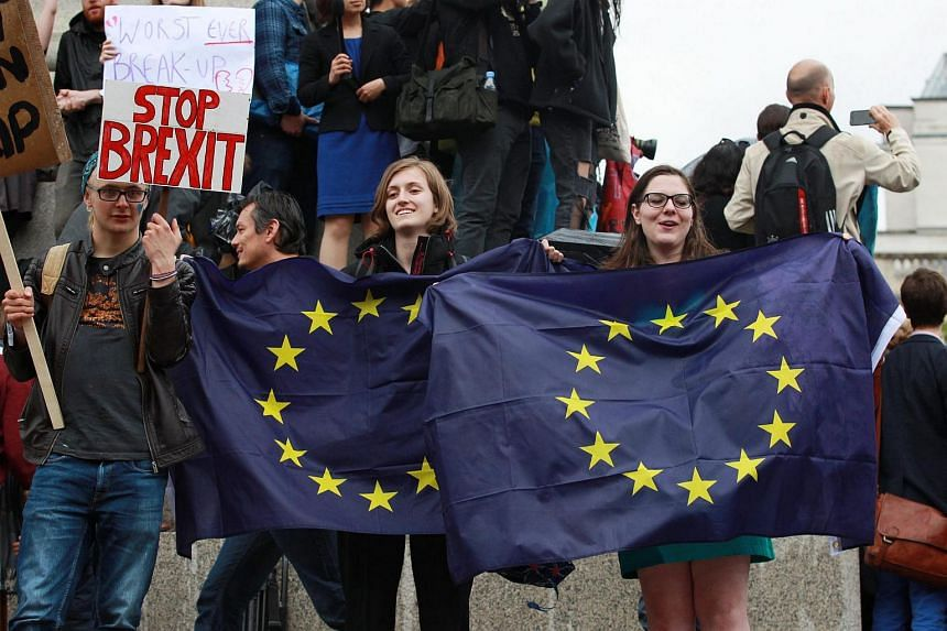 People take part in a Brexit referendum anti leave result demonstration in Trafalgar Square, central London Britain, on June 28.