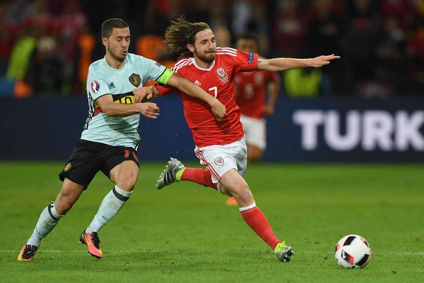 (From left to right) Belgium's forward Eden Hazard and Wales' midfielder Joe Allen vie for the ball during the Euro 2016 quarter-final football match between Wales and Belgium at the Pierre-Mauroy stadium in Villeneuve-d'Ascq near Lille, on July 1.
