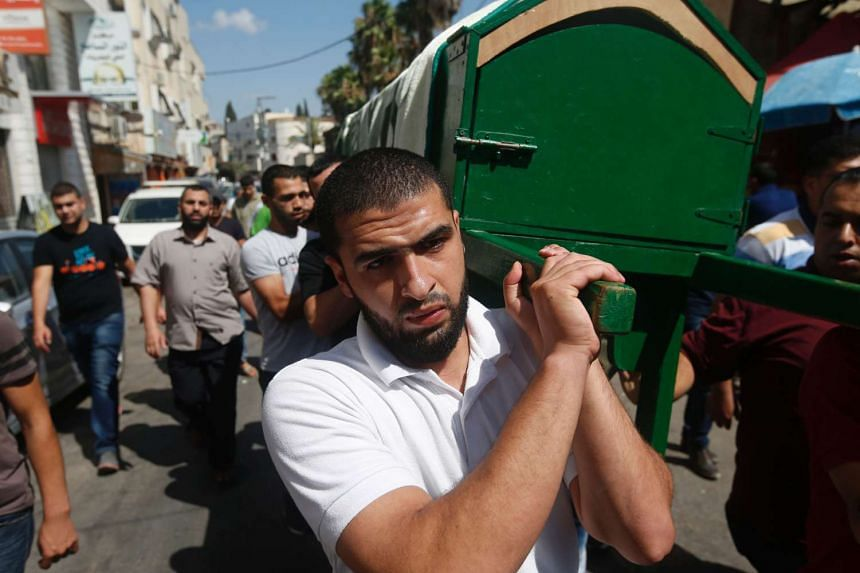 Mourners carry the coffin of Sondos al-Basha, a Palestinian woman killed in the attack, in the West Bank town of Qalqilyah on July 1, 2016.