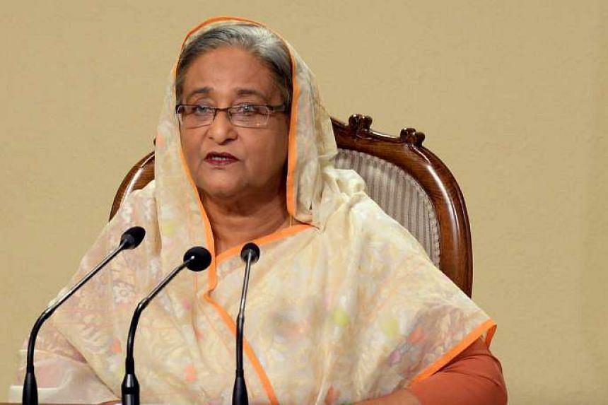 Sheikh Hasina delivers a TV address to the nation after armed attackers stormed an upscale restaurant in a bloody siege.