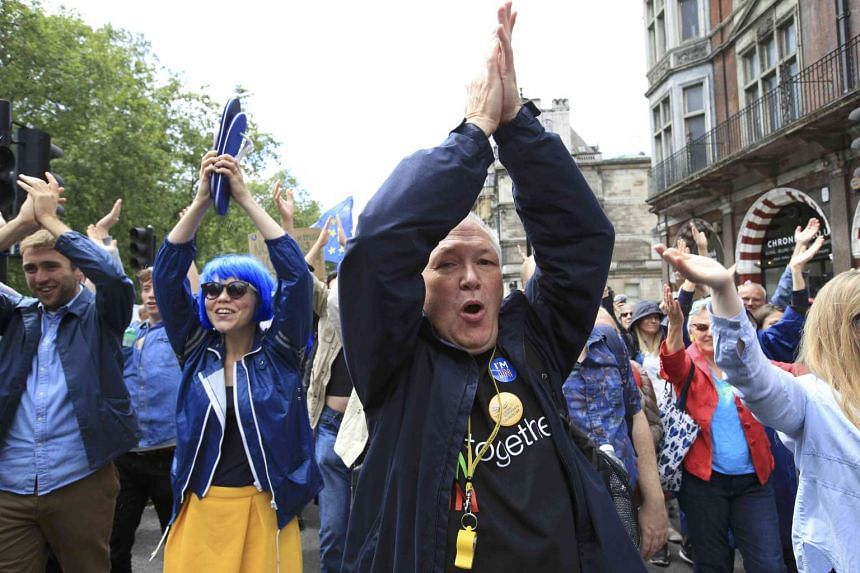 """People shout at a """"March for Europe"""" demonstration against Britain's decision to leave the EU, in London, on July 2, 2016."""