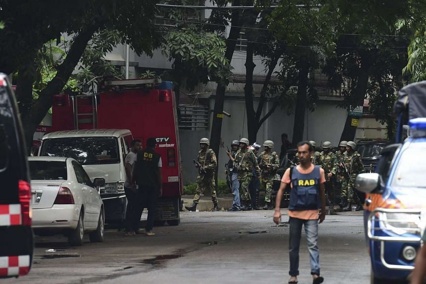 Bangladeshi army soldiers patrol a street during a rescue operation in Dhaka's high-security diplomatic district on July 2, 2016.