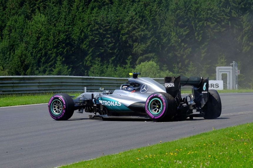 Nico Rosberg sits in the car after crashing during the third practice session of the F1 Grand Prix of Austria in Spielberg, Austria, on July 2, 2016.