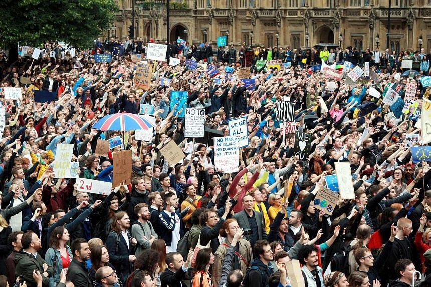 People protest outside Westminster protest against the Brexit in London on June 28. A protest march will happen on July 2 as well.