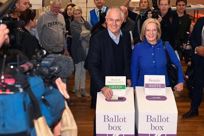 Australia's PM Malcolm Turnbull (left) and his wife Lucy cast their vote in Sydney on July 2.