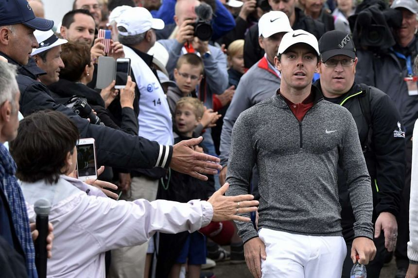 McIlroy arrives at the 1st tee during the second round of the 100th French Golf Open on July 1, 2016.