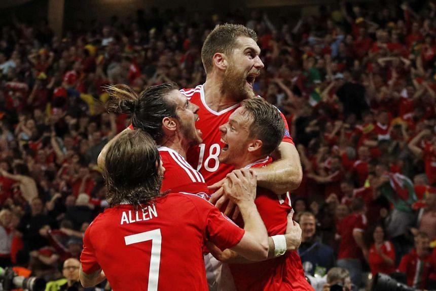 Wales' Sam Vokes celebrates scoring their third goal