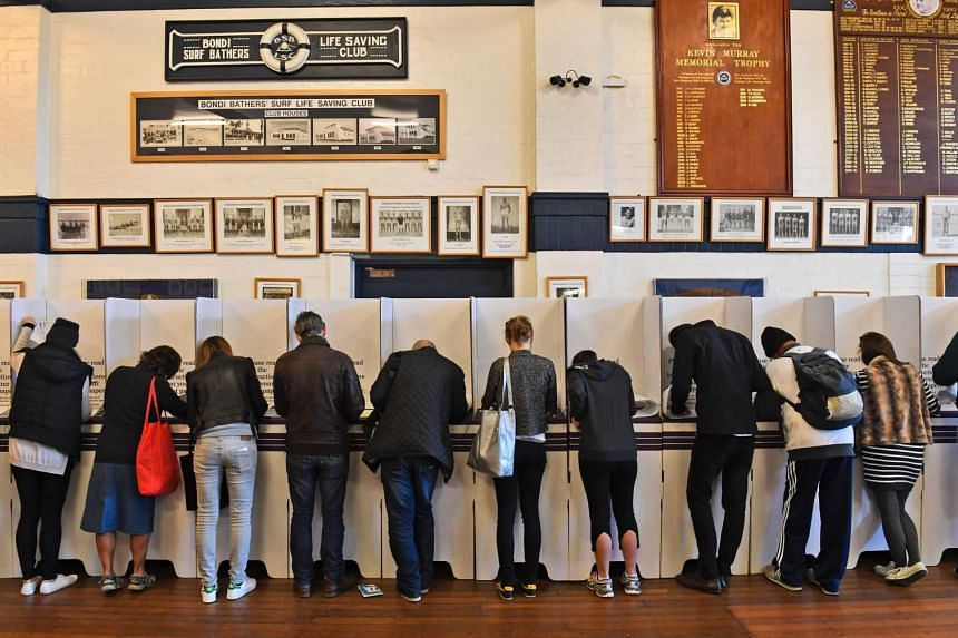 People vote at a voting station in the Sydney suburb of Bondi Beach on July 2.