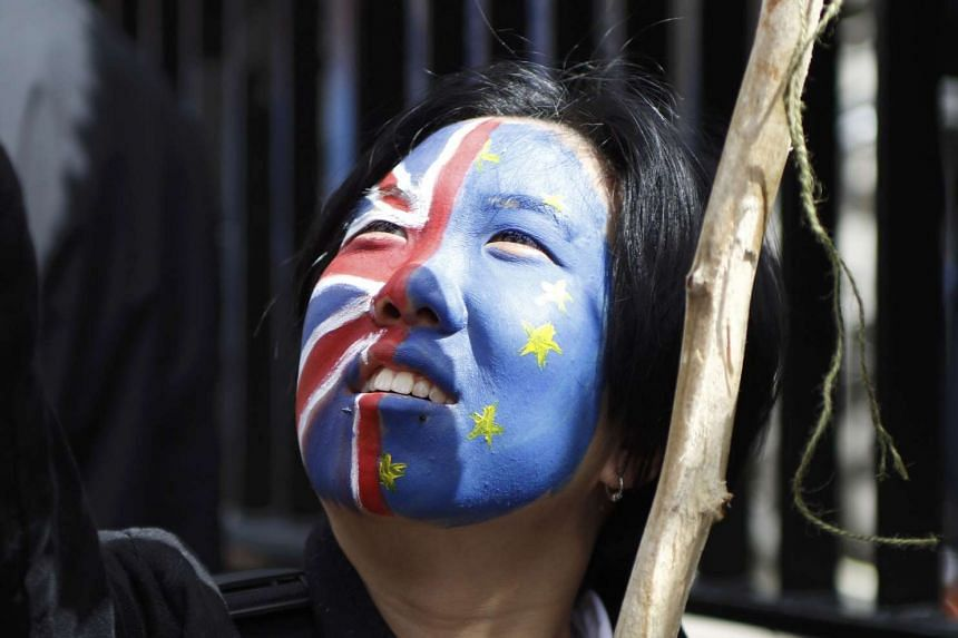 """A woman taking part in a """"March for Europe"""" demonstration against Britain's decision to leave the EU."""