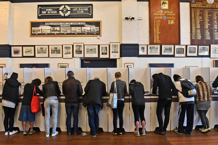 People casting their votes during the Australian national election, at Bondi Beach on July 2, 2016.