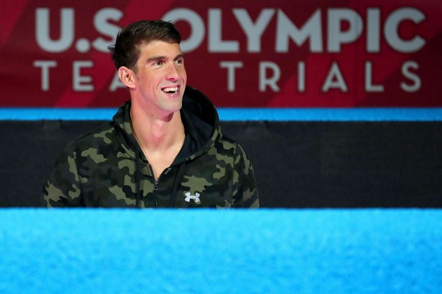 Michael Phelps smiling during the medal ceremony for the Men's 100-metre butterfly  in Omaha. Nebraska, on July 2, 2016.