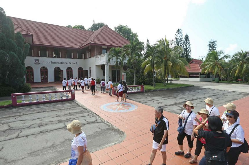 Members of the public on guided tours around the premises on July 3, 2016 with the main building, the Old Admiralty House, in the background.