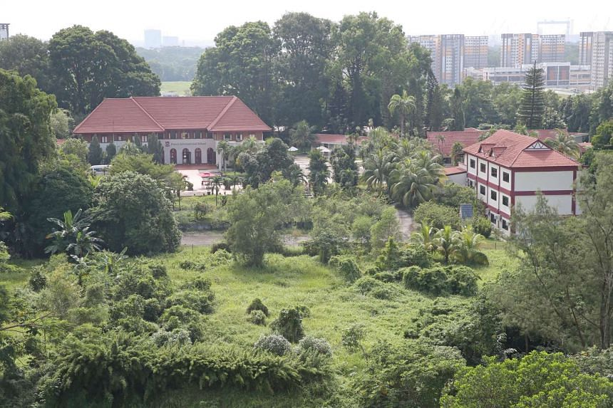 A view of the site for the new integrated sports and community hub in Sembawang, which includes the old Admiralty House (left).