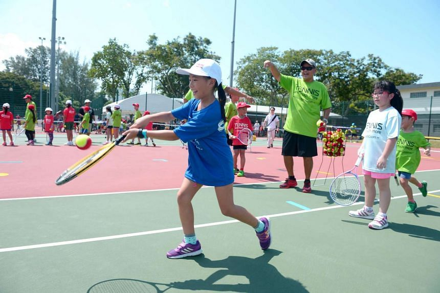 Koh Wensyn learning to play mini tennis at the ActiveSG tennis academy launch at Kallang Tennis Centre on July 3, 2016.