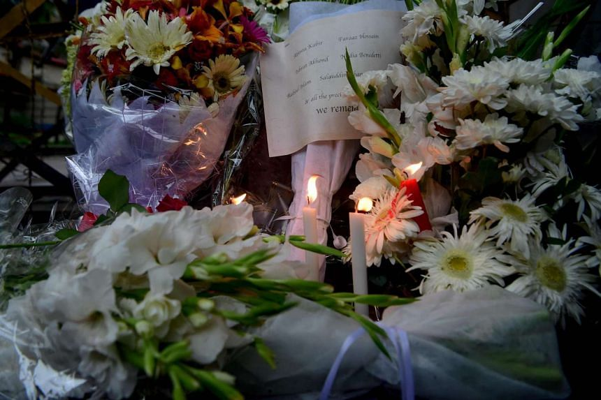 Flowers and candles are left at a memorial site for victims of the Bangladesh cafe siege, in Dhaka, on July 3, 2016.