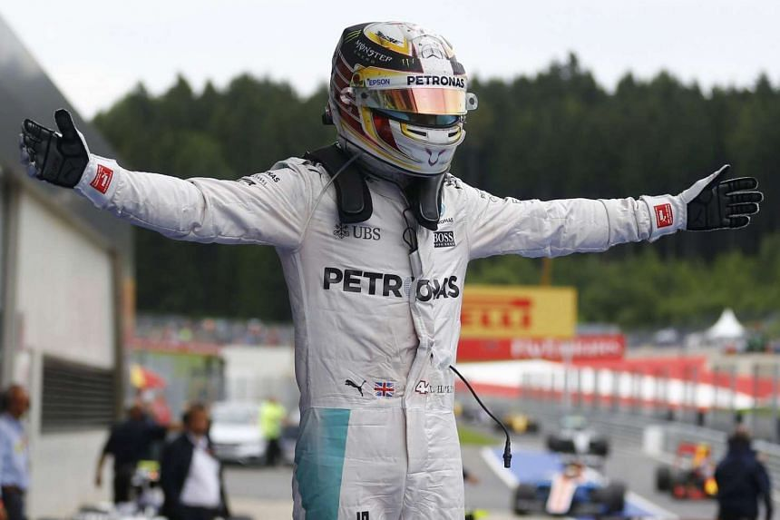 Mercedes Formula One driver Lewis Hamilton of Britain reacts after the 2016 Formula One Grand Prix of Austria  in Spielberg on July 2, 2016.