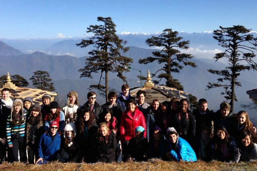 Yuan Kelly (bottom row, right), with her classmates from Think Global School posing for a photo along Bhutan's Dochula Pass.