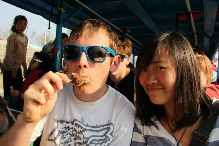 Yuan Kelly (right) and a classmate on the Mekong ferry in Golden Triangle, Thailand.