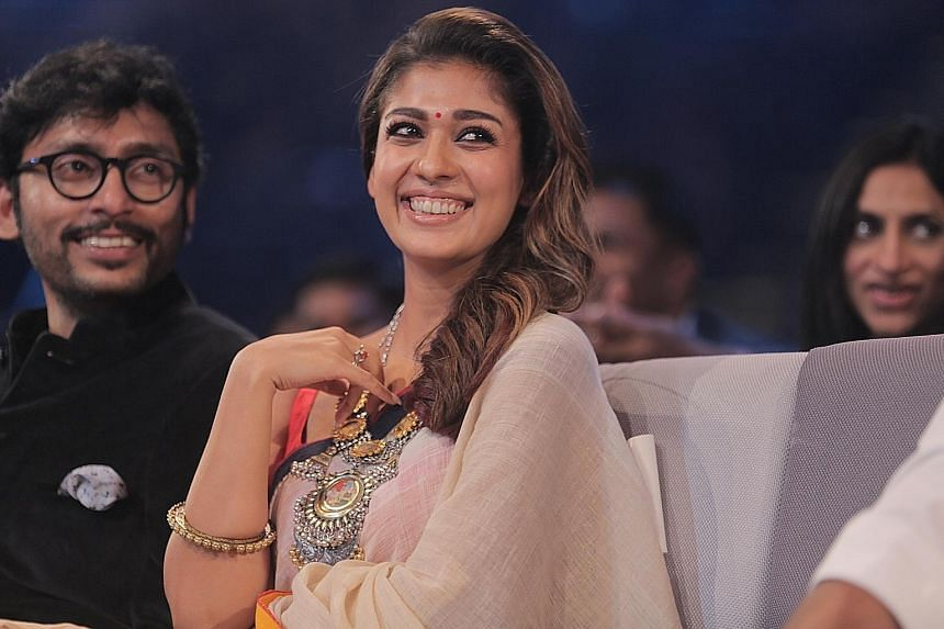 Nayanthara won Best Actress for both the Tamil and Malayalam film categories. Beside her is RJ Balaji, who won Best Comedian (Tamil).