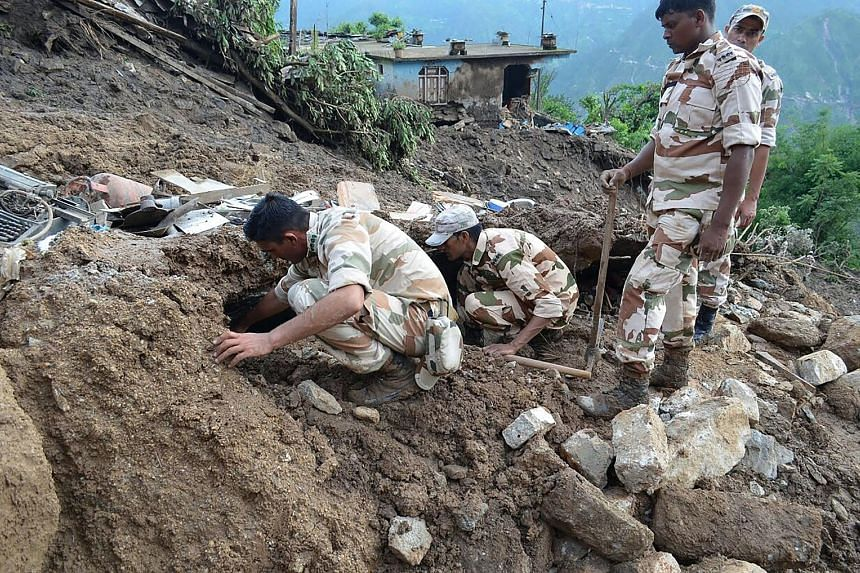 More than 40 people have been killed in landslides in south-west China and northern India. Officials said 20 people were killed after a huge landslide (left) swept through a village in China's Guizhou province last Friday. The National Meteorological