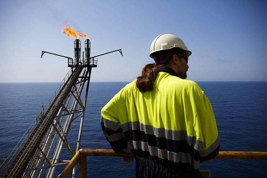 An oil platform off the coast of Spain. Oil prices plunged to a 12-year low of US$27.88 per barrel in January before recovering to US$50 in June. The disruptions in the supply chain, for example through the Canadian forest fires, have reduced supply,