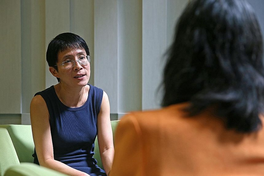 Dr Lee with Madam Goh, who was one of 14 patients in the NCIS trial. In the trial, doctors use the body's natural killer cells to stop the progression of late-stage breast cancer.