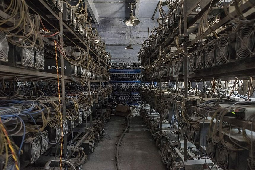 Bitcoin mining machines line the shelves at a server farm in Guizhou, China. Through canny investments and vast farms of computer servers dispersed around the country, a handful of Chinese companies have effectively assumed majority control of the bi