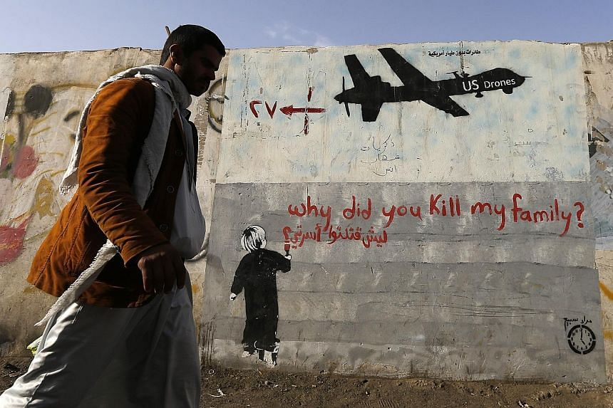 Graffiti on a wall in Sanaa, Yemen, denounces strikes by US drones. US President Barack Obama, to whom the drone programme is personal and a defining feature of his presidency, has issued an executive order making civilian protection a priority and r