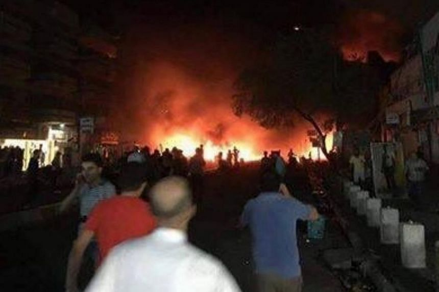 Several dozen people were killed or injured in two bombings that hit a shopping area and a popular market in Baghdad.