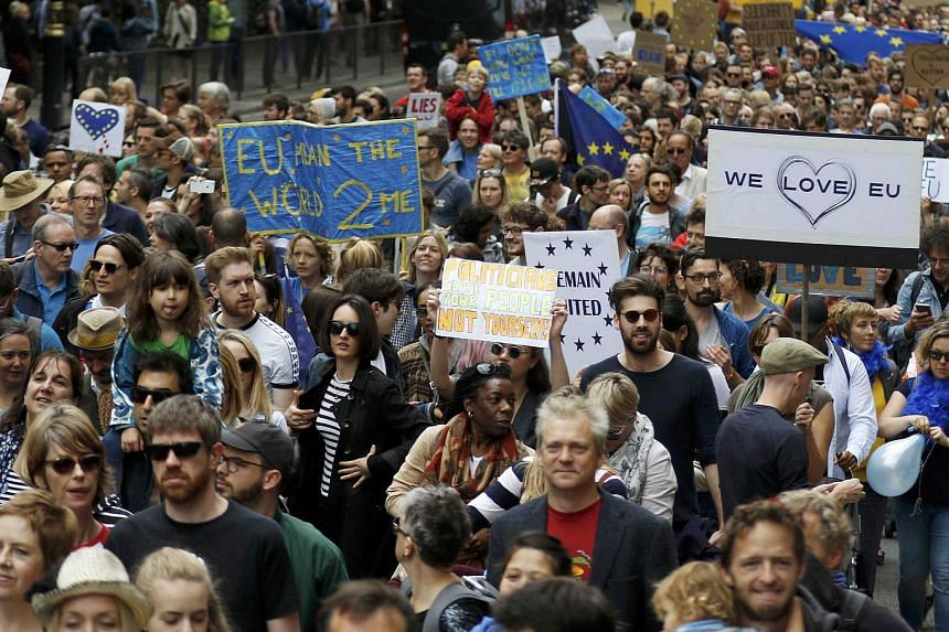People hold banners during a 'March for Europe' demonstration against Britain's decision to leave the European Union, in central London.