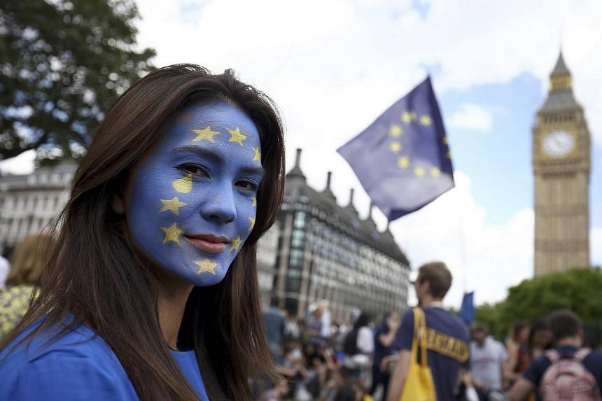 A woman with a painted face poses for a photograph during a 'March for Europe' demonstration against Britain's decision to leave the European Union, in central London.