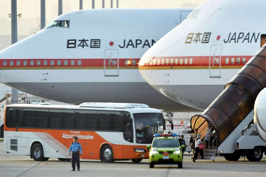 People boarding Japanese government airliners which are scheduled to ferry family members of the terror victims to Dhaka, Bangladesh, at Haneda Airport in Tokyo, on July 3, 2016.