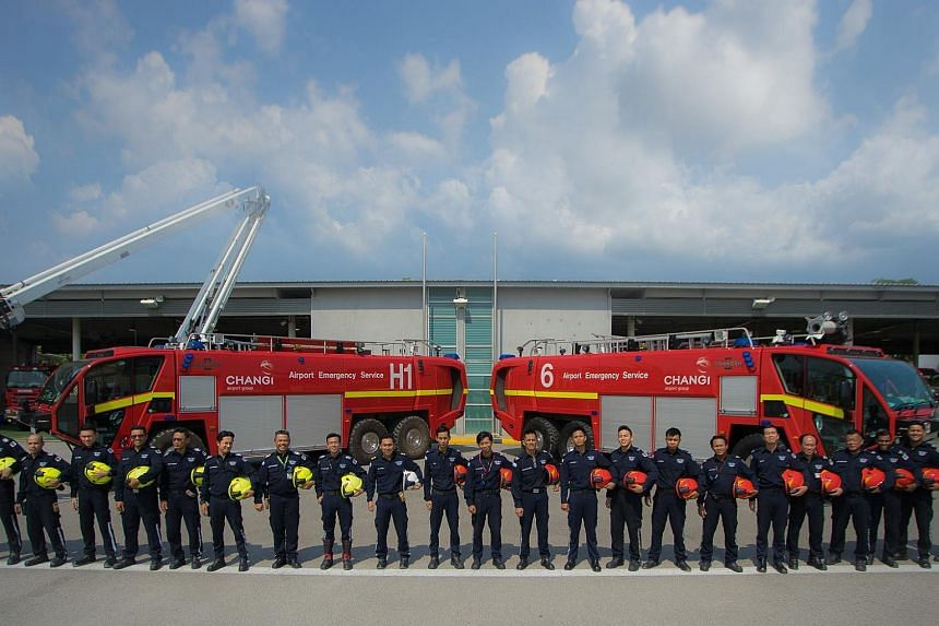 The Airport Emergency Service team posing with their equipment.