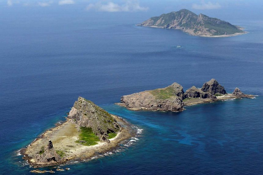 A group of disputed islands, known as Senkaku in Japan and Diaoyu in China, is seen in the East China Sea, in Sept 2012.