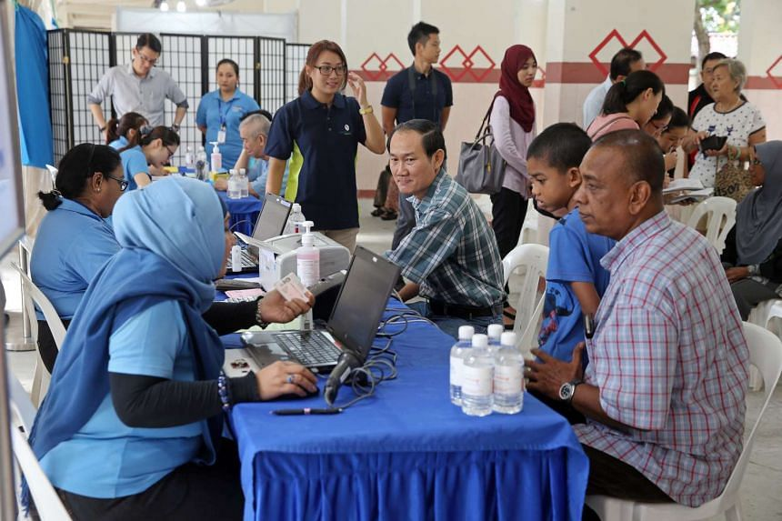 Current and former residents of Block 203, Ang Mo Kio Avenue 3, underwent a free tuberculosis screening provided by the Health Ministry, on June 16, 2016.