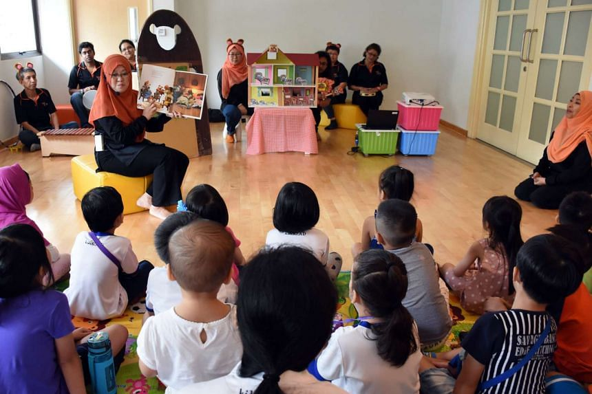 Children with special needs participate in a story-telling session at North East Community Toy Library, on June 19, 2016.