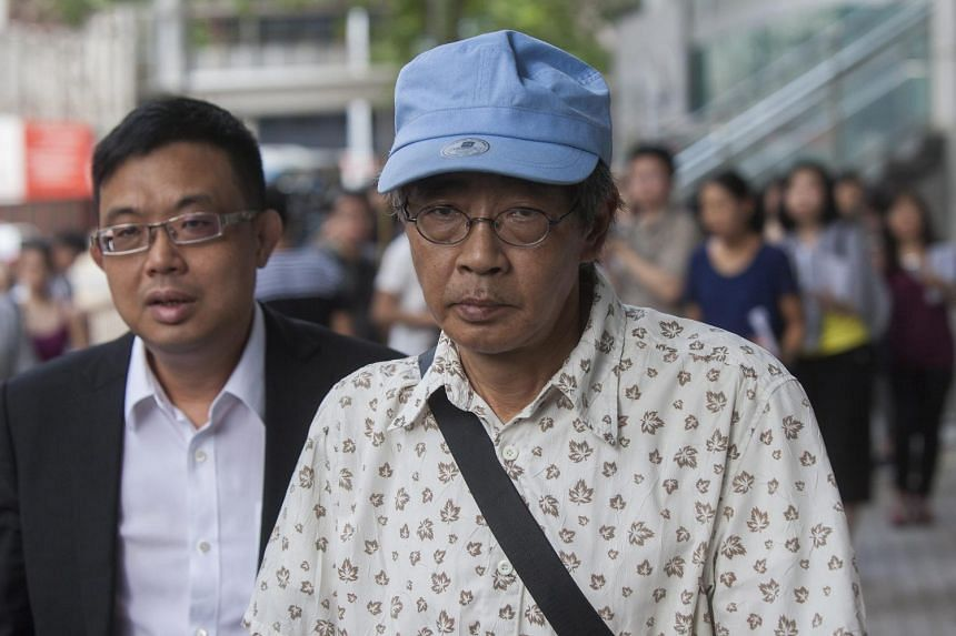 Formerly imprisoned Hong Kong bookseller Lam Wing Kee (right) leaves after his visit to Hong Kong's Police headquarters on June 27, 2016.