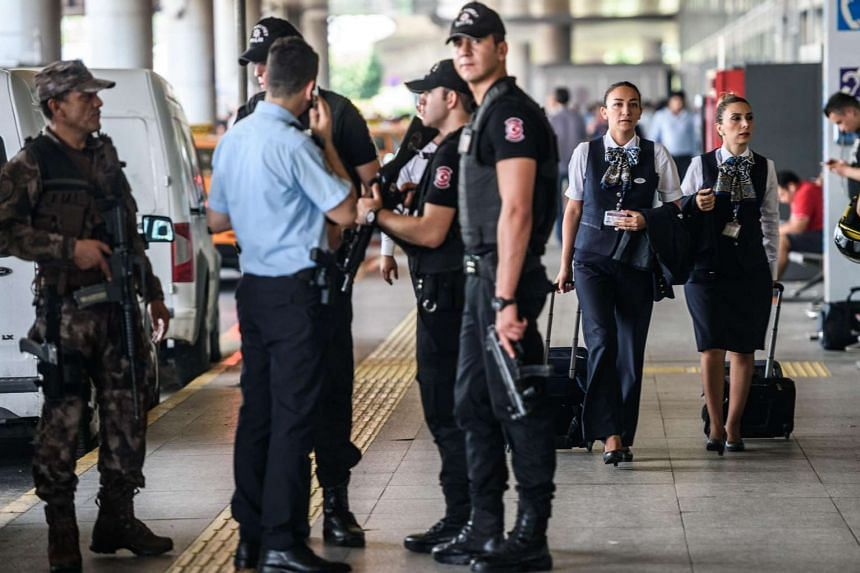 Turkish special force police officers stand guard at Ataturk Airport on July 1, 2016.